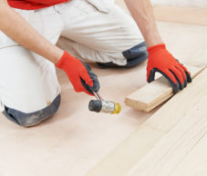 bigstock-carpenter-worker-installing-wo-84833978